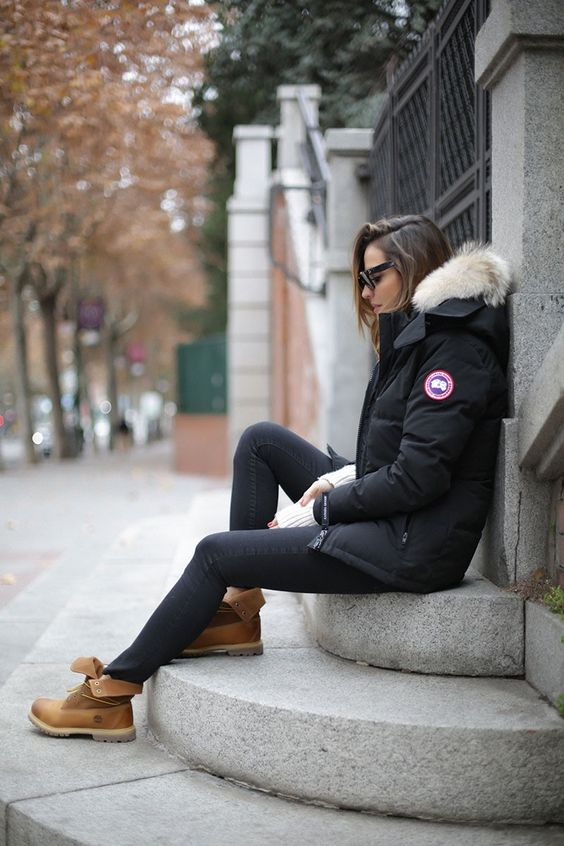 Timberlands are the perfect item to break up an all black winter outfit. Silvia Zamora wears this pair with black denim and a cool Canada Goose parka with a faux fur hood. Parka: Canada Goose, Jeans/Jumper: Zara, Sunnies: Céline.: