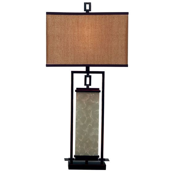 Combining colonial and modern elements, the Abriella table lamp has a versatile appearance. The forged look of oil rubbed bronze and antiqued frosted glass gets modern panache from a clean rectangular shape.