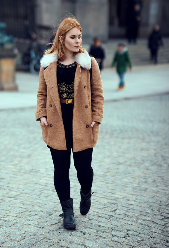 A perfect winter outfit with a golden belt, a brown coat and a black velvet dress