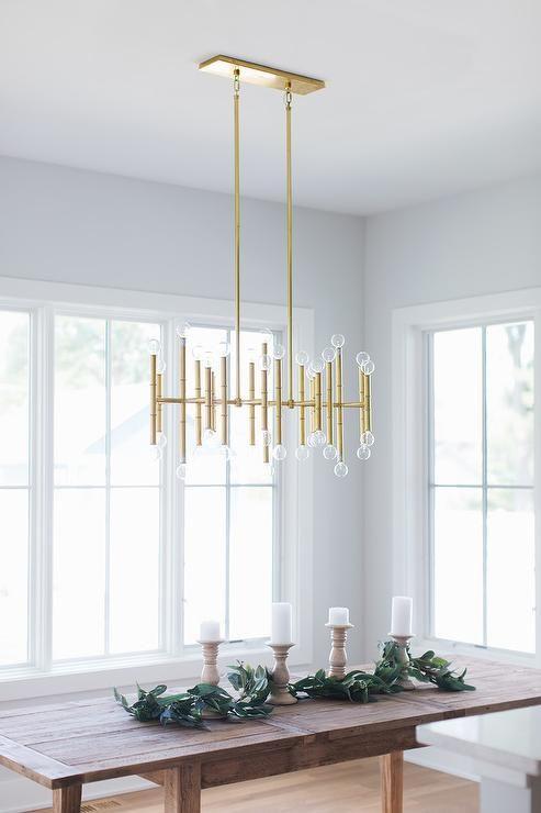 A Jonathan Adler Meurice Rectangular Chandelier Lights A Wood