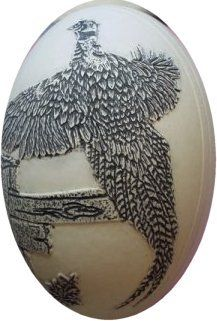 Scrimshaw style on eggshells.  The eggs are carved lightly using a high  speed drill for the main lines.  A knife is then used for fine details.  India ink is  applied and the excess  wiped away carefully.