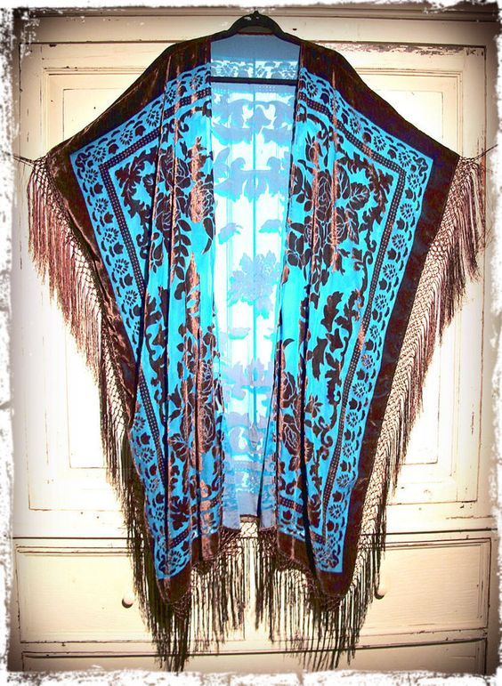 "Soooooooo GOOD! Awesome vintage inspired caftan! Great with anything and everything year round, truly a timeless piece! Gorgeous art deco floral pattern...back takes one shawl so there is no seam and the square shape creates a beautiful effortless drape.  Insanely gorgeous color combo in turquoise and rich brown simply to-die-for! Silk fishnet fringe goes all the way down the sides and along bottom creating incredible movement. Total length including fringe is 51""One size..."