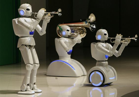Toyota Motor Corporation partner robots play instruments at the company's showroom in Tokyo on May 4, 2008