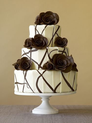 An Elegant Tiered Wedding Cake with Chocolate Roses. Lovely.