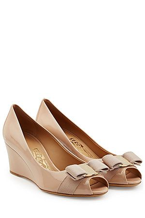 Slip your soles into these glossy patent leather wedges from Salvatore Ferragamo. The nude color promises not to date while the bow makes them instantly recognizable #Stylebop