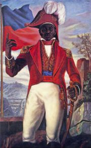 Jean-Jacques Dessalines... In the back of this picture is the Haitian flag. The white part of the French flag was removed. The remaining blue was taken to represent Haiti's citizens and the red to represent les gens de couleur (the people of color).: