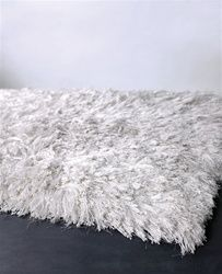 White fluffy rug for the living room. The coffee table/leather ottoman will go on this in front of the couch.