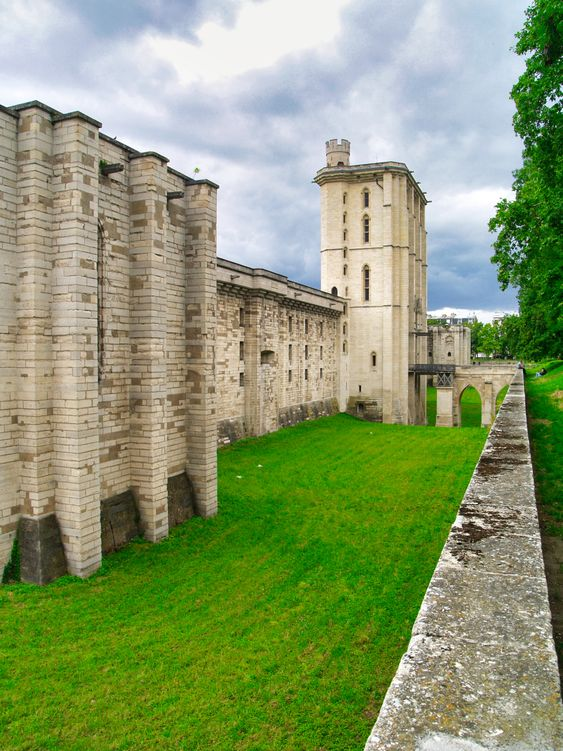 Château de Vincennes is a 14th century French royal castle located in the town of Vincennes, now a suburb of Paris.  This castle constructed during 1340 - 1410 A.D.  The castle is surrounded by a 7-meter dry moat and accessed over stone bridges.  During the 18th century, after the castle was abandoned by the royal family, it was used for a time as a porcelain factory, then as a prison, and later as a military fortress and arsenal.