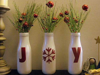 """DIY - Spray painted glass bottles with """"JOY"""" adhesive decals applied. Nice idea."""