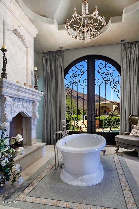 Luxury master bathroom this is so cool with the fireplace for Bathrooms with fireplaces