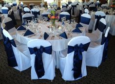 pics of wedding reception tables with navy chevron table runner - with white chair covers and navy sashes and blue napkins
