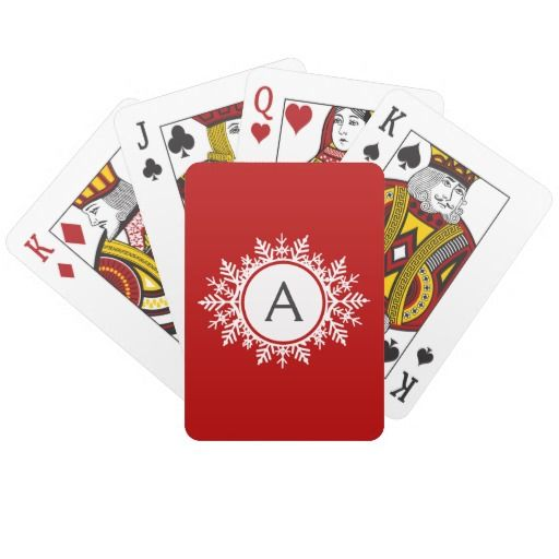 Ornate White Snowflake Monogram on Festive Red Playing Cards  An ornate snowflake monogram against a festive red background. Delicate and sweet.