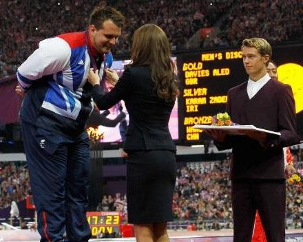 HRH The Duchess of Cambridge awards the gold medal to Team GB member Aled Davies' neck in victory.