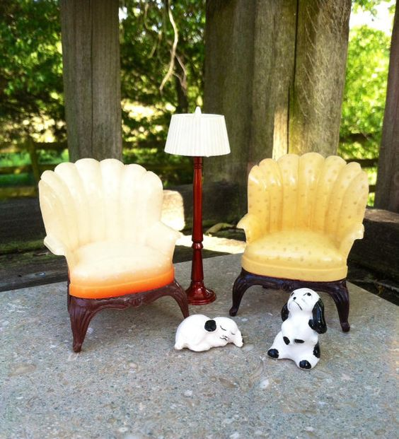 Vintage dollhouse furniture items including a charming pair of