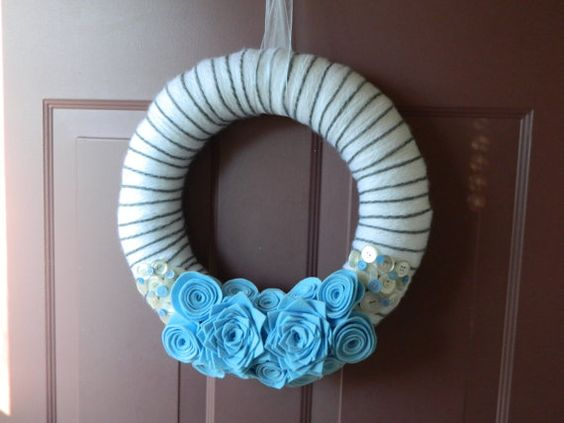 Baby Wreath - 14 Inch White Yarn Wreath with Blue Flowers and Buttons. $40.00, via Etsy.