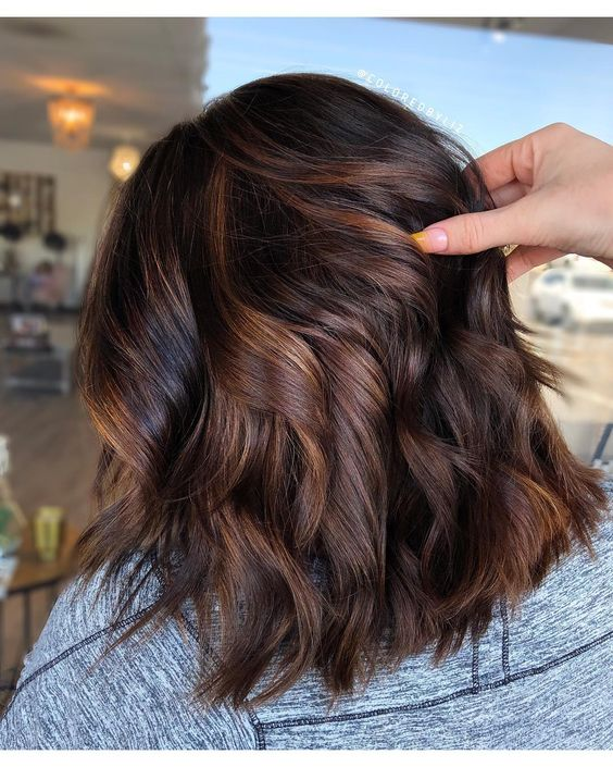 """Chocolate cake"" is a new hair color trend in which balayage highlights make brown hair look especially rich and vibrant. Here's what to ask your colorist to do."