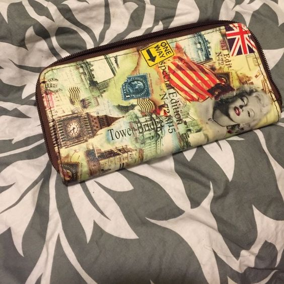 A colorful very pretty Marilyn Monroe wallet! I bought last year only wore a couple times it has some wear but still in great condition like new! ❤️ Bags Wallets
