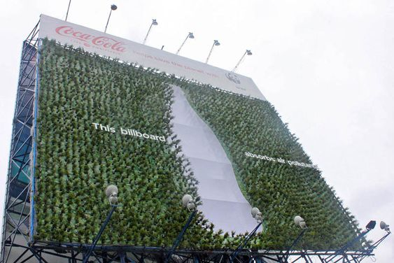 outdoor ads-green billboard with plants to suck up carbon coca cola-www.ifiweremarketing.com