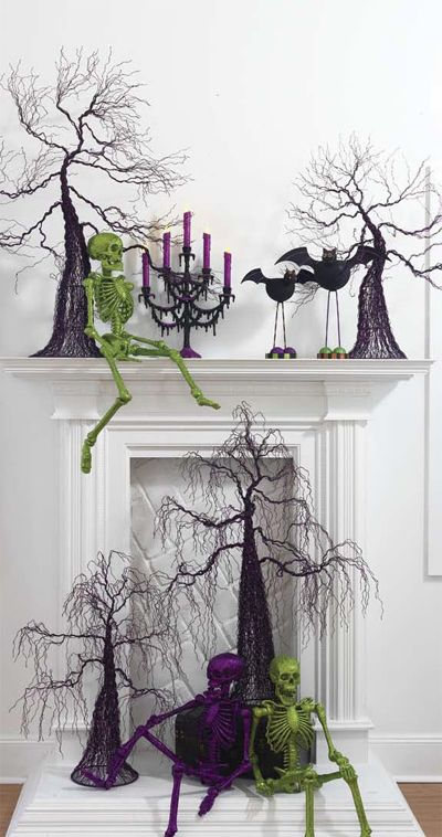 There are SO many halloween decoration ideas here!  But I loved the idea to spray paint and even glitter your skeletons!  Things you can get at a dollar store!  Great idea!  Love this mantle!