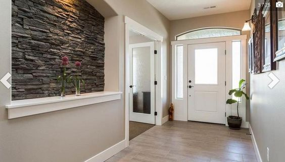 I love the cutout in the wall with the stone. I want this in my next house!