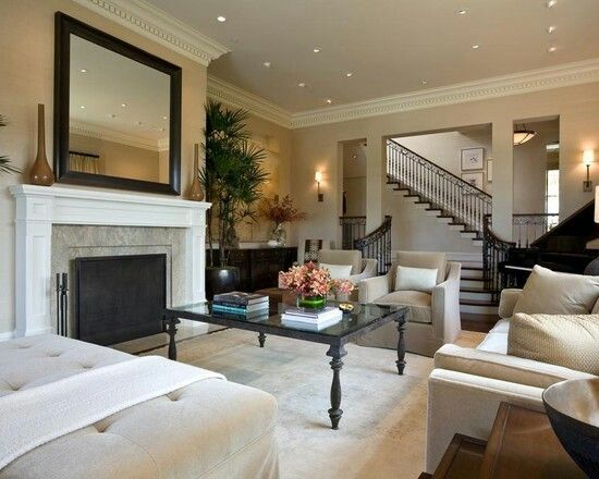 Enjoy the overall look... medium laminate floors, neutral walls, white trim, pretty staircase!