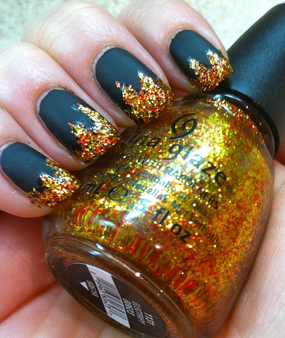 """THE HUNGER GAMES: """"Girl On Fire"""" inspired manicure! District 12 coal has caught fiery flames! Just like Katniss' nails before the games. My nails are ready for the midnight movie premiere!   OPI """"Blacky Onyx"""",  Essie """"Matte About You"""" matte topcoat,  China Glaze """"Electrify"""" from the Capitol Colours Collection."""