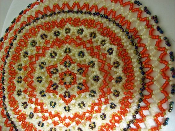 Red cream and iridescent beaded doily by Tehhonya on Etsy