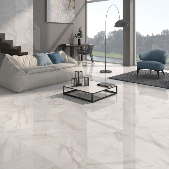 Calacatta white gloss floor tiles have a stylish marble effect finish in either grey or beige. These large white tiles are made from quality porcelain and are an attractive, hardwearing option for any home. Please contact Direct Tile Warehouse for help with choosing white floor tiles.