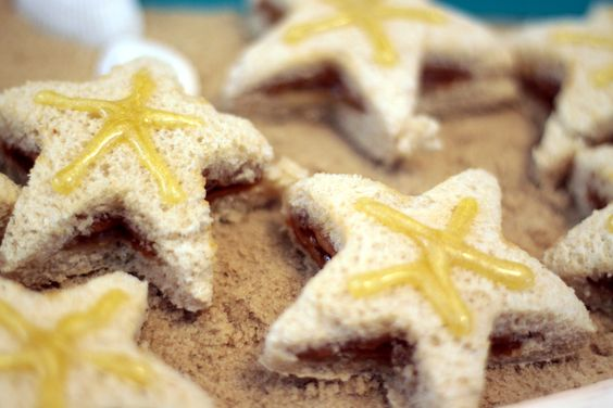 An easy tutorial for making starfish sandwiches using peanut butter and honey.