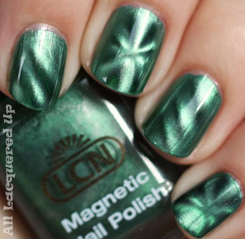 I love the patterns you get with Magnetic nail polish...a little odd to know theres iron powder in my polish, but the end result, & using the magnet to create it, is very fun! :)  (pic & post on alllacqueredup.com)