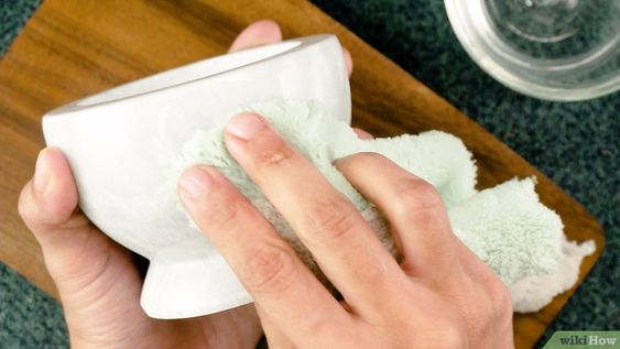 4 Try hydrogen peroxide. Pour a little hydrogen peroxide over the stained area. Cover with plastic wrap and let it rest for twenty-four hours. Lift the plastic wrap and wipe away the hydrogen peroxide with a damp cloth. Repeat if necessary.