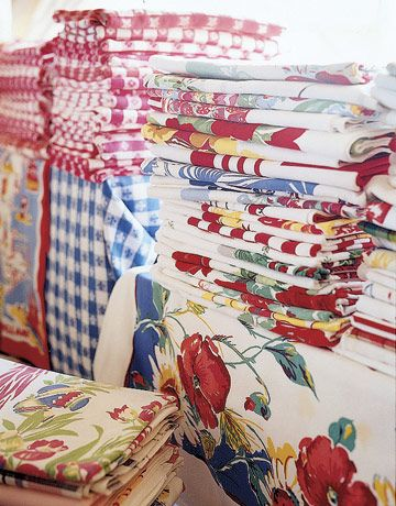 happiness is a pile of pretty vintage tablecloths