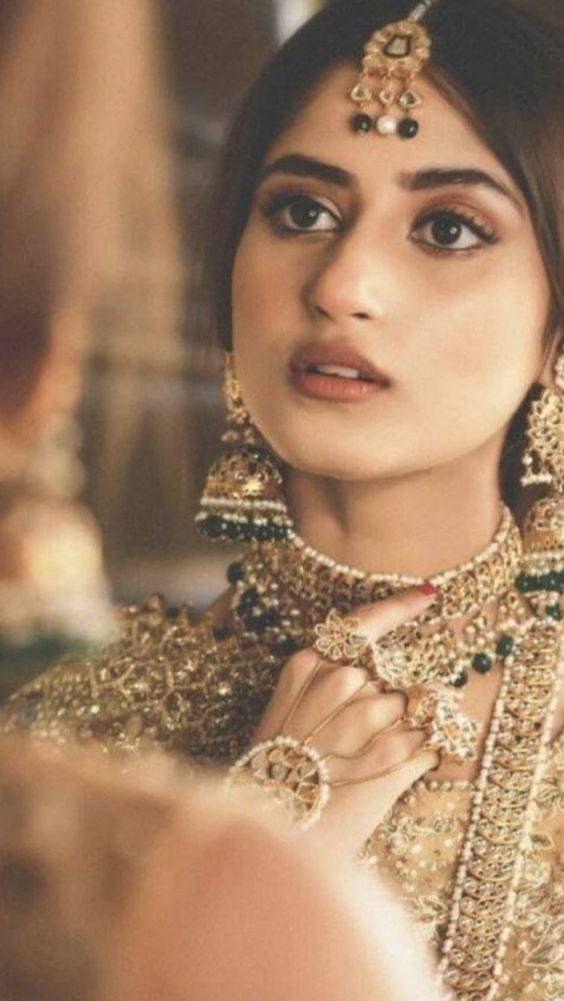 Elegant gold jhumkas for brides