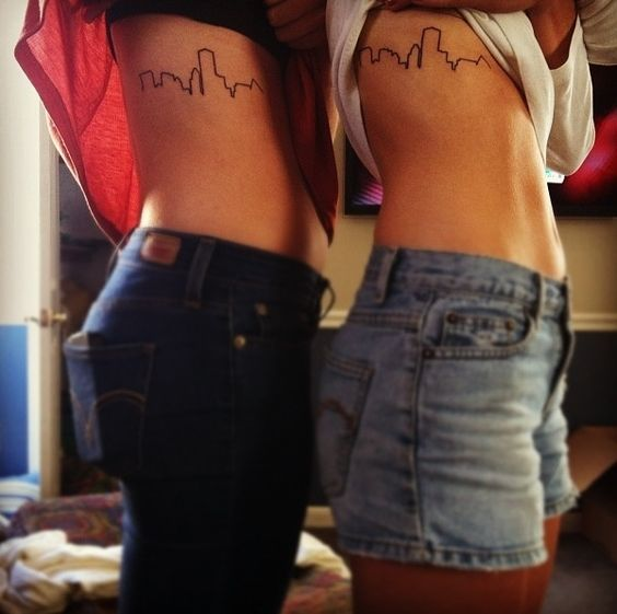 Rib tattoos city skylines and small tattoos on pinterest for Tattoo removal milwaukee
