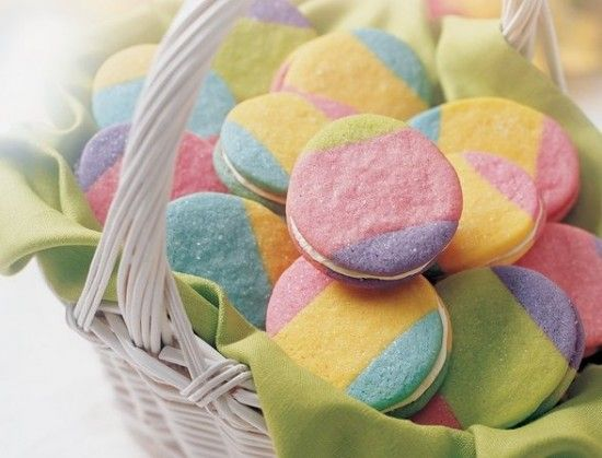 Rainbow egg sugar cookies with creamy vanilla frosting. So fun and colorful for Easter.