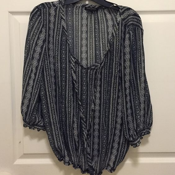 Banana Republic blouse Lightweight blouse which is a little sheer so will need to wear a tank underneath. Material is 100% polyester. Tie closure at neck line with button closures at the elbow length sleeves. Bottom of top is gathered. Banana Republic Tops Blouses
