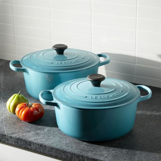 "Revered by both professional chefs and home cooks since its 1925 debut, Le Creuset's classic French cookware is prized for its utilitarian good looks, unsurpassed heat retention, and lids that create an even ""blanket"" of heat. Cast iron round French oven is clad in smooth, vitrified porcelain (here in vibrant tropical blue), rendering each piece impervious to acid, alkali, odors and stains. The addition of the French oven's lid allows the heat to surround the food, cooking it evenly; the…"