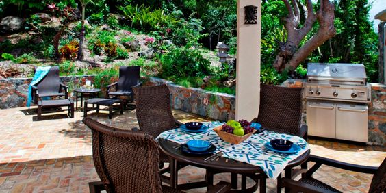 The covered patio has a pro-grade grill and is backed by verdant gardens. #Jetsetter