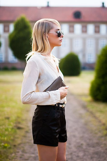 Sophia Molen is wearing a blouse from Zara, shorts from Made In The Shade, sunglasses from & Other Stories and the bag is from Filippa K