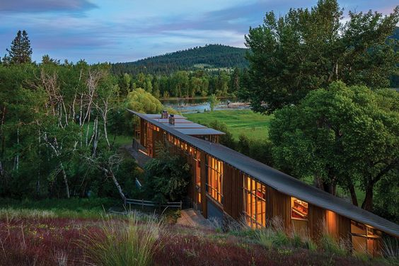 Complex Montana Glass Home Embedded in a Dreamlike Natural Landscape