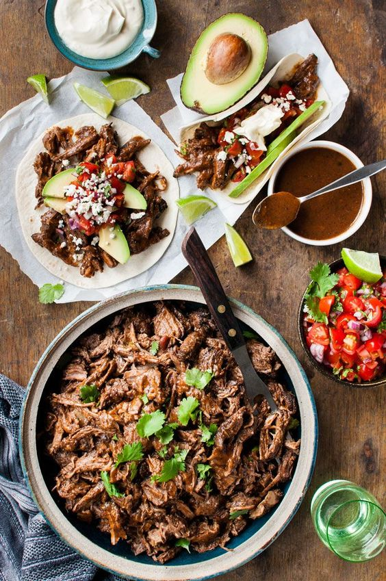 Mexican Shredded Beef (and Tacos) - Easy to make, in the slow cooker, on the stove or even in the oven!