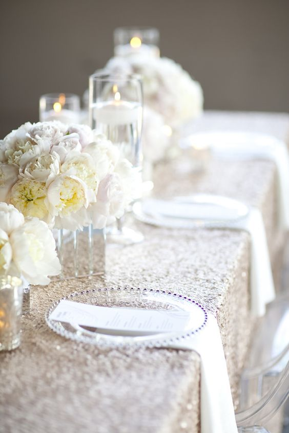 the prettiest pale peonies, the most gorgeous sequin linens, loads of candlelight and ghost chairs to boot. this table HAS IT ALL  Photography by ykvision.com, Styling and Floral Design by zestfloral.com