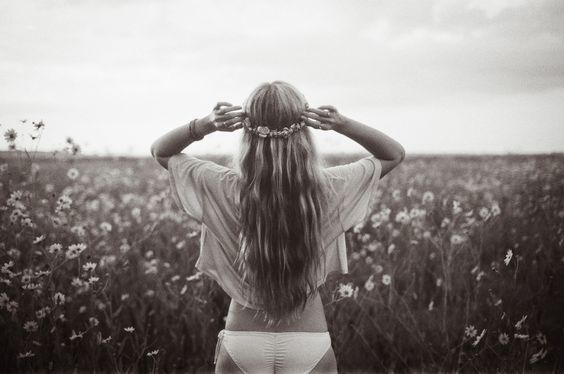 black and white film photo of a hippie girl in a large flower field / Josh Letchworth Photography
