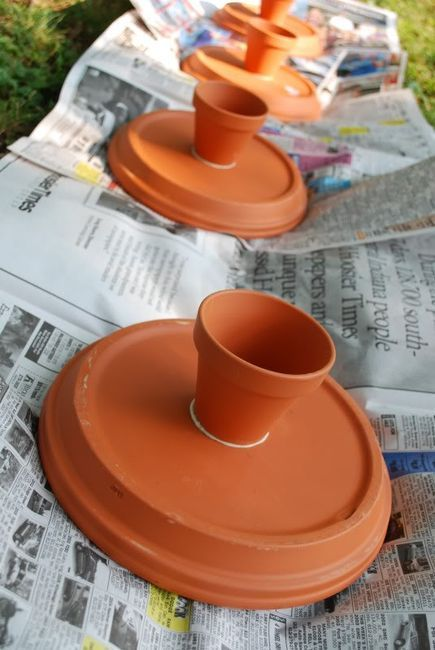Cake stands from terra cotta pots, would be cute painted: