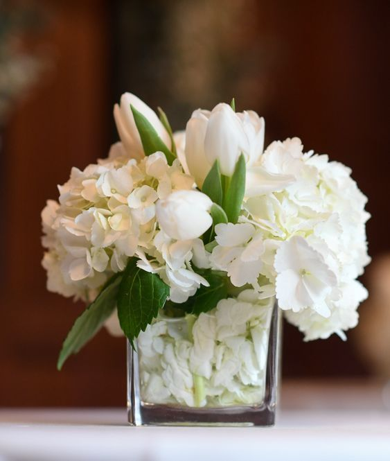 Pin By Darcy Mahoney On Wedding Ideas White Flower Centerpieces Tulip Centerpieces Wedding White Flower Arrangements