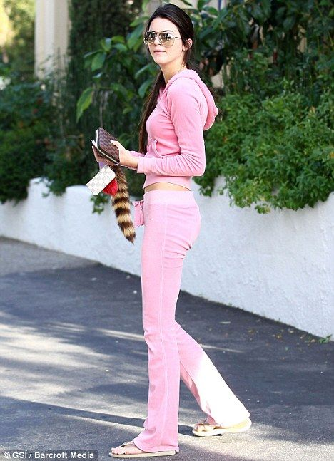 Pink to make the boys wink: Kendall Jenner wore this brightly coloured velour tracksuit for the girls' day out to Blue Table gourmet deli in Calabasas, California