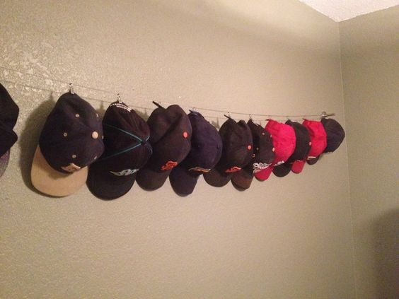 diy hat display cable from ikea with clipped baseball