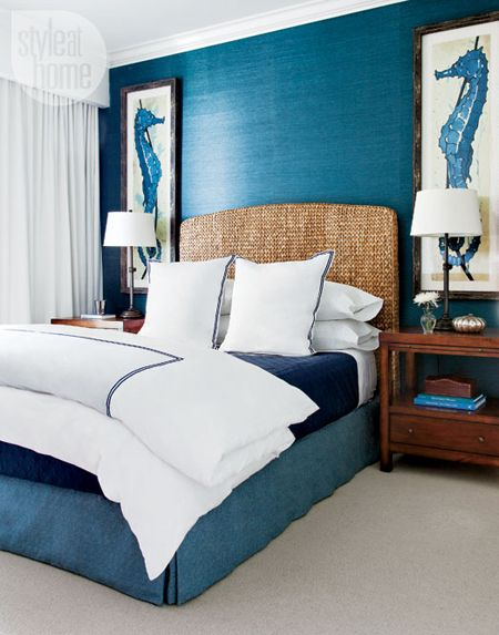 A more masculine room with darker colors of blue, the seahorses help make it all feel like the ocean. The woven headboard just helps to pull it all into a real beach themed bedroom.