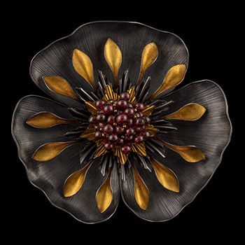 """Judith Kinghorn - """"Poppy with Garnets"""" in sterling silver and 24k gold."""