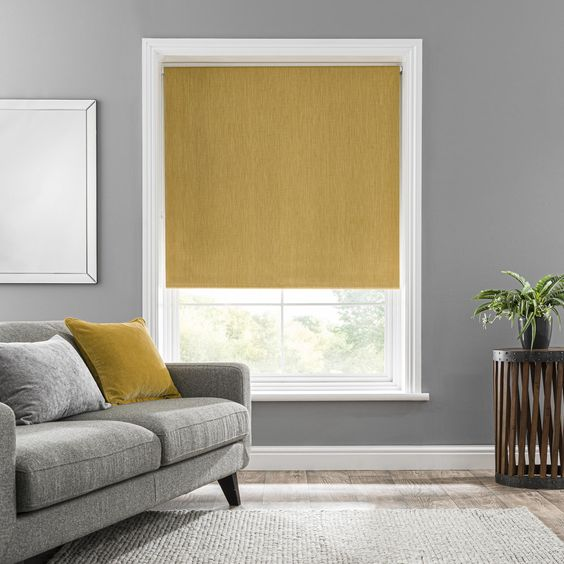 Fashioned in a vibrant mustard tone and crafted from textured woven fabric, this blackout roller blind is ideal for bringing colour and texture to your décor. The premium blackout coating prevents unwanted light from entering your home while improving privacy, making this blind ideal for use in bedrooms. Plain in design to effortlessly complement a variety of decorative styles, this roller blind is available in a selection of sizes and is supplied with wall fixings included.Please note: The widt